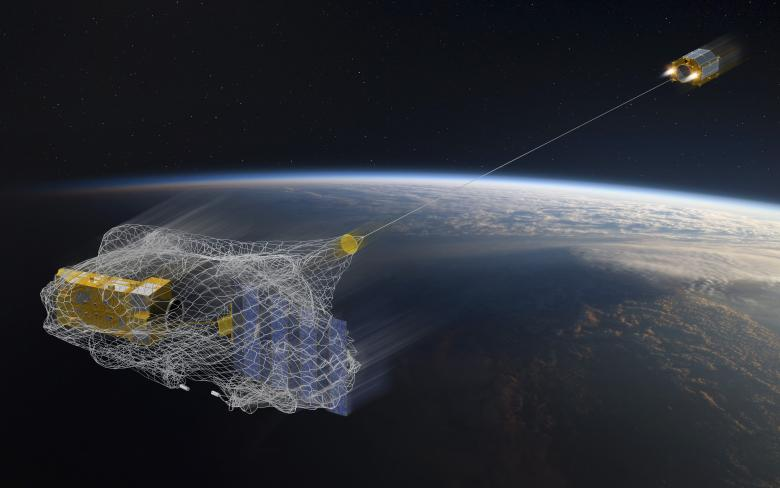 'RemoveDEBRIS' is a small satellite equipped with a harpoon and a net. Its aim is to find the best way of capturing space debris.